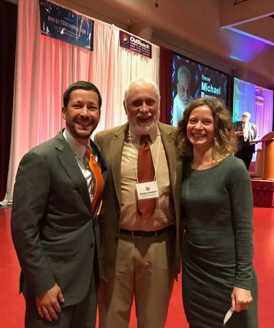David Koehler, left, OutReach Executive Director Steve Starkey, and Elizabeth Koehler celebrate the work and the legacy of Bill Wartmann at OutReach's 26th annual awards banquet.